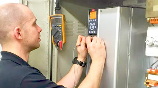 Engineer running a repair test on a unit