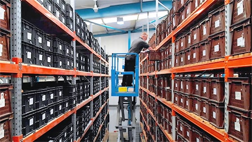 Employee picking spare parts from the warehouse